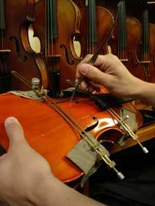 Picture of a cracked violin being repaired
