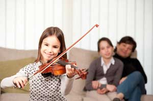 Girl taking violin lessons