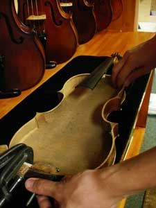 Violin being repaired with top removed