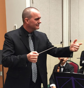 Jeremy Woolstenhulme conducting his orchestra