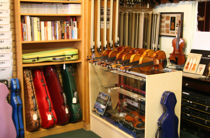Violins, Bows, and Colorful Cases Around the Store