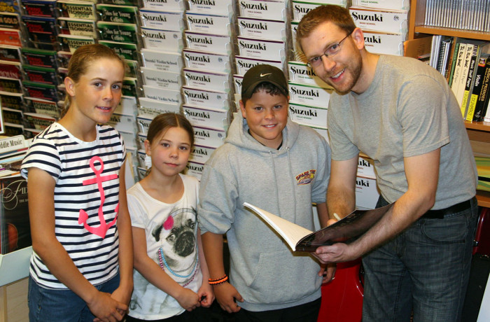 Young Customers get a Special Autograph