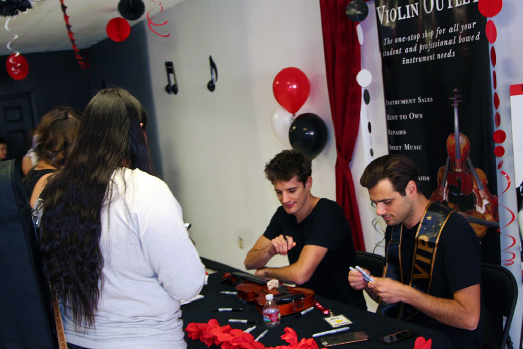 2Cellos Signing Books and Instruments