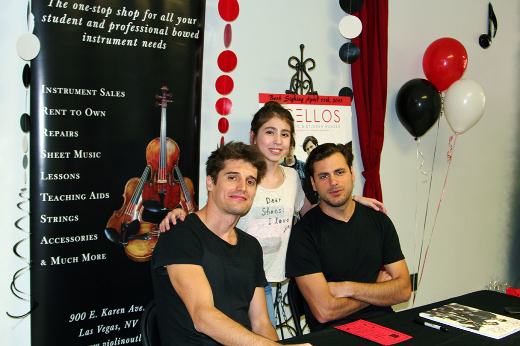 2Cellos pose with a young fan