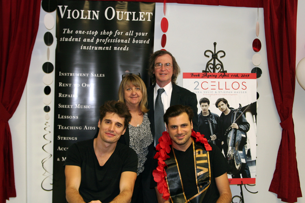Mara and Gary Lieberman pose with 2Cellos
